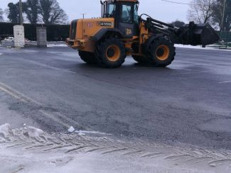 snow being cleared away by club staff